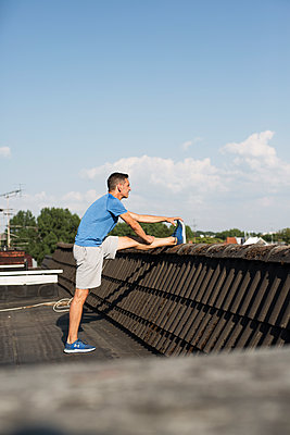 Stretching on roof - p341m2008630 by Mikesch