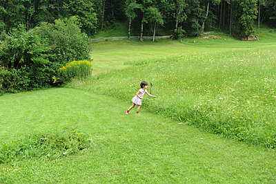 Child playing in garden - p56710524 by Ilka Kramer