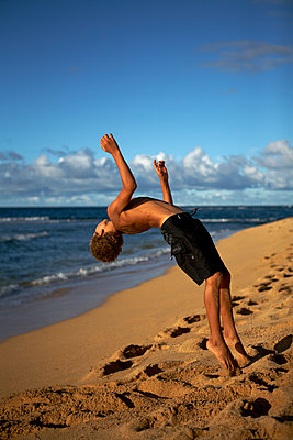 Boy Playing on Beach - p1260m1077974 by Ted Catanzaro