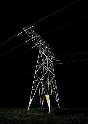 Power pylon at night - p429m2004558 by Mischa Keijser