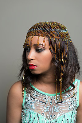 Young black woman in  exotic gold headdress. - p1433m1589019 by Wolf Kettler