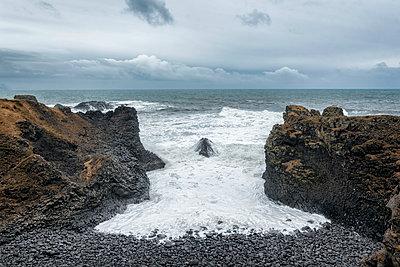 Rocks on beach near ocean, Hellissandur, Snaellsnes peninsula, Iceland - p555m1491151 by Patrick Lienin