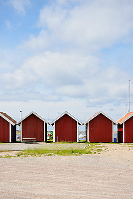 Sweden, Kungshamn, Row of typical red wooden houses - p300m2213678 by Biederbick&Rumpf