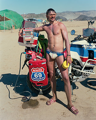 Man with bike - p1118m1540313 by Tarik Yaici