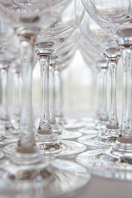 Drinking glasses on table - p1057m1526202 by Stephen Shepherd