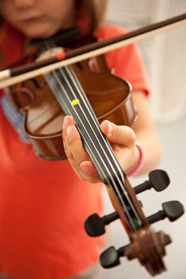 Girl playing violin - p301m714546f by Maria Jauregui Ponte