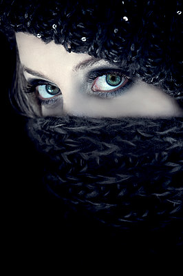 Woman hiding face behind black scarf - p1445m2128300 by Eugenia Kyriakopoulou