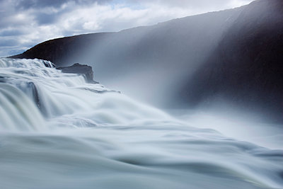 Thundering water at Gullfoss, Iceland's most famous waterfall, with sunlight streaming down through the spray, near Reykjavik, Iceland, Polar Regions - p871m1073131f by Lee Frost