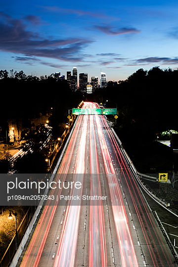 Road traffic to Los Angeles in the evening - p1094m2057243 by Patrick Strattner