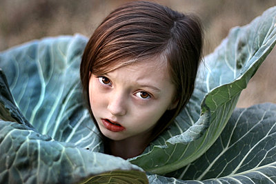 Girl wrapped in cabbage leaves - p1019m2149532 by Stephen Carroll
