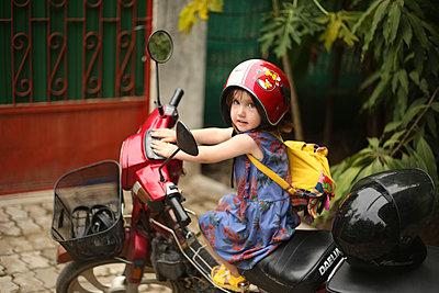 Girl on motorbike - p1160m1582867 by Emilie Reynaud