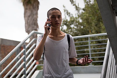 Young man talking on mobile phone - p1315m2018294 by Wavebreak