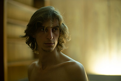 Bare chested young man - p1321m2087836 by Gordon Spooner