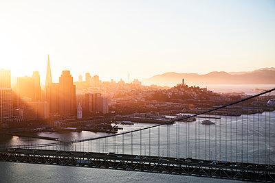 Bay Bridge over San Francisco Bay against cityscape - p1166m1164436 by Cavan Images