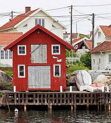 Fishing shed on coastline - p575m711028f by Lars-Olof Johansson