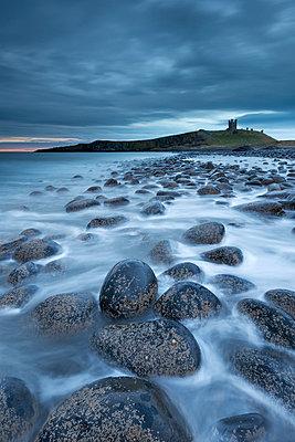 Dunstanburgh Castle at dawn from Embleton Bay - p871m838828 by Adam Burton