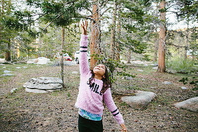 Girl reaching branch at Inyo National Forest - p1166m1488913 by Cavan Images