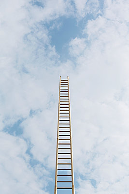Ladder under cloudy sky - p1340m1465820 by Christoph Lodewick