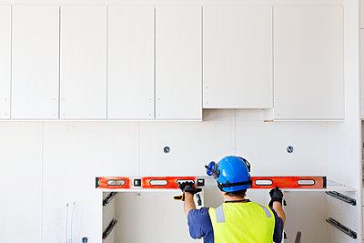 Builder at work - p312m1187708 by Susanne Kronholm