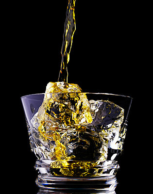 Glass filled with whiskey - p5490332 by C&P