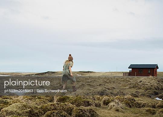 Girl Running to House - p1503m2015963 by Deb Schwedhelm