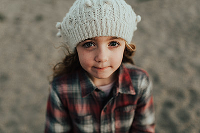 High angle portrait of cute girl wearing knit hat while standing on field - p1166m1489480 by Cavan Images