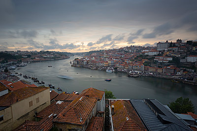 View over Porto and river Douro at dusk, Portugal - p300m2119669 by Christina Falkenberg