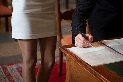 Signing the certificate of marriage - p445m1452443 by Marie Docher