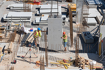 Construction workers on building site - p1292m2151584 by Niels Schubert