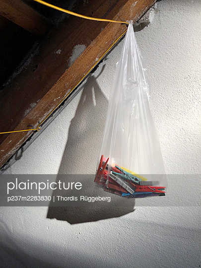 Bag with clothes pegs in the attic - p237m2283830 by Thordis Rüggeberg