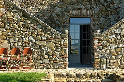 Stone house with entrance flanked by staircases - p1183m996921 by Touillon, Bernard