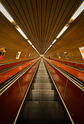 Low angle view of escalators in underground station in Prague city - p623m2271899 by Pablo Camacho