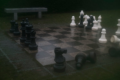 Large chess pieces on board at park - p301m1406543 by Michael Mann