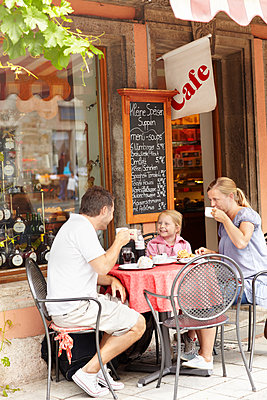 Family in outdoor cafe - p312m1070424f by Michael Jonsson
