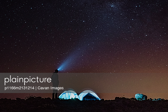 A man in the base camp under the stars - p1166m2131214 by Cavan Images