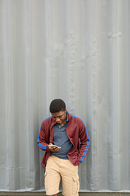 Teenage boy using smart phone - p1192m2024313 by Hero Images