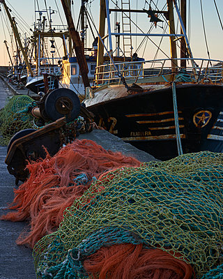 Trawlers alongside and nets, Newlyn, Cornwall, England, United Kingdom - p871m2113948 by Baxter Bradford