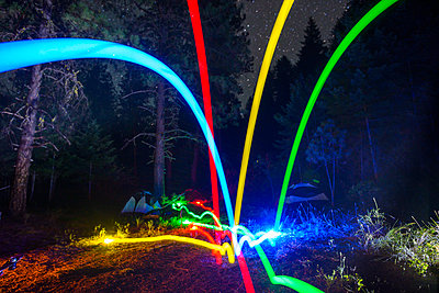 Colorful Light Trails Bocce Ball at Night - p1166m2078030 by Cavan Images