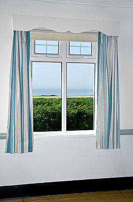 Sea and Landscape View through Curtained Window - p1562m2296991 by chinch gryniewicz