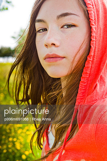 Portrait Of A Girl Wearing A Hooded Sweatshirt And Looking Tough