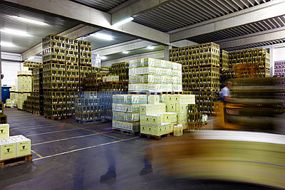 Stacked wine boxes in a depot - p1299m2231853 by Boris Schmalenberger