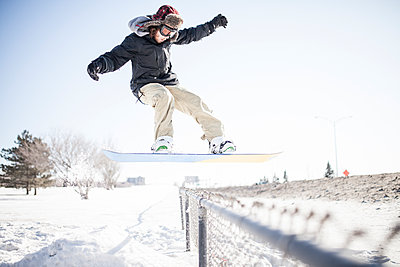 Friends snowboarding during winter - p1362m1227719 by Charles Knox