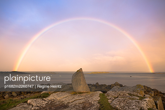 Rainbow over the ocean in Brittany, France - p1682m2260747 by Régine Heintz