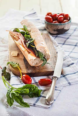 French bread with Jamon serrano, cheese, tomatoes and lettuce - p300m1023416f by Susan Brooks-Dammann