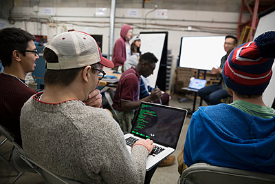 Hackers with laptop pitching ideas at hackathon - p1192m1202050 by Hero Images