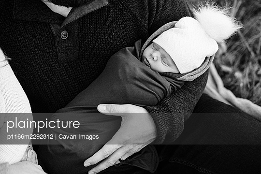 black and white photo of a newborn swaddled baby - p1166m2292812 by Cavan Images