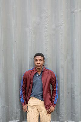 Portrait confident teenage boy - p1192m2024318 by Hero Images