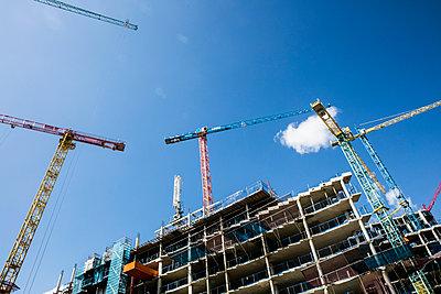 Construction site with cranes - p1082m1466471 by Daniel Allan