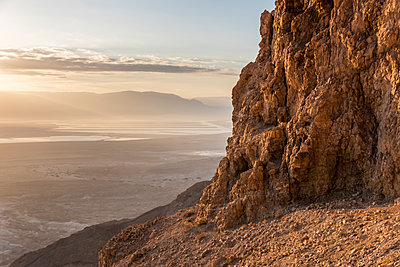 A rugged, rock cliff and a view of the Judaean Desert; South District, Israel - p442m1449203 by Keith Levit