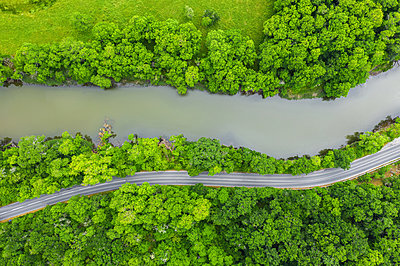 Aerial view from drone over a road around a river - p1596m2186999 by Nikola Spasov